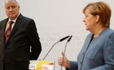 Horst Seehofer und Angela Merkel bei der Pressekonferenz zu den Unions-Verhandlungen. Foto: Odd Andersen | AFP