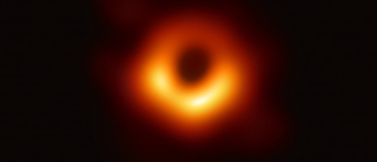 "A handout photo provided by the European Southern Observatory on April 10, 2019 shows the first photograph of a black hole and its fiery halo, released by Event Horizon Telescope astronomers (EHT), which is the ""most direct proof of their existence,"" one of the project's lead scientists told AFP. (Photo by – / EUROPEAN SOUTHERN OBSERVATORY / AFP) / RESTRICTED TO EDITORIAL USE – MANDATORY CREDIT ""AFP PHOTO / EUROPEAN SOUTHERN OBSERVATORY"" – NO MARKETING NO ADVERTISING CAMPAIGNS – DISTRIBUTED AS A SERVICE TO CLIENTS"