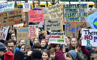 """Youths demonstrate with banners and placards during the """"Fridays For Future"""" movement on a global day of student protests aiming to spark world leaders into action on climate change on March 15, 2019 in Berlin. – The worldwide protests were inspired by Swedish teen activist Greta Thunberg, who camped out in front of parliament in Stockholm last year to demand action from world leaders on global warming. (Photo by Tobias SCHWARZ / AFP)"""