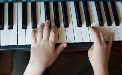 shutterstock: https://www.shutterstock.com/image-photo/close-childs-hand-playing-piano-favorite-1729636717