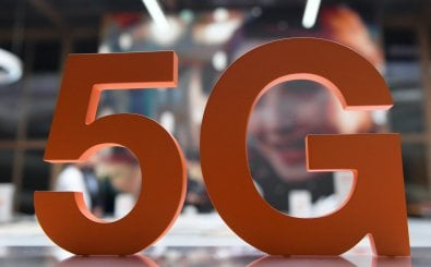 A 5G logo is pictured at the Orange stand during the Mobile World Congress (MWC) fair in Barcelona on June 29, 2021. (Photo by Josep LAGO / AFP)